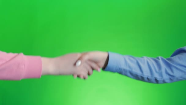 Friends shaking hands. Handshake wiht two hands, keyed green screen