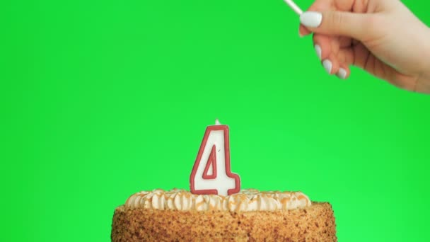 Osvětlení číslo čtyři narozeninová svíčka na lahodný dort, zelená obrazovka 4