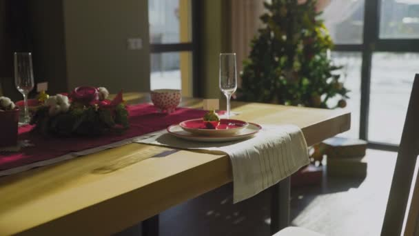Beautiful Christmas table with Christmas tree on baclgrounds