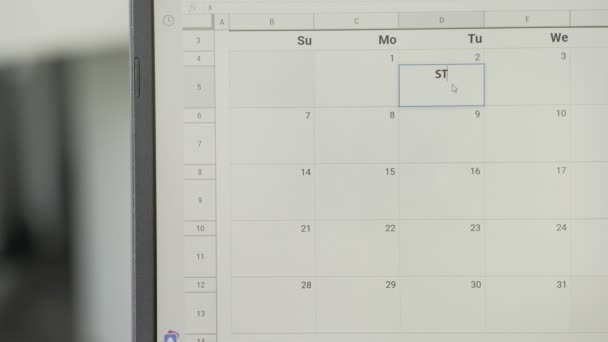 Writing STUDY TIME on monthly weekly planner calendar to remember this date.