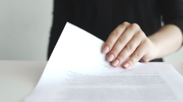Female hand that puts an ILLEGAL stamp in the contract or documents.