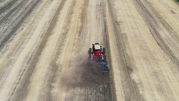 Aerial view of farming tractor spraying on field with sprayer, herbicides and pesticides