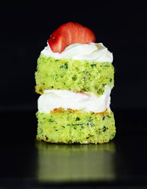 still life food confectionery mint cake with cream and strawberry