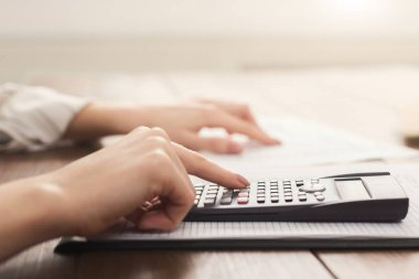 Female accountant or banker making calculations