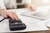 Woman managing finances on laptop