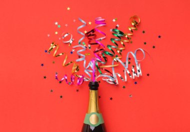 Champagne bottle with colorful party streamers on red background stock vector