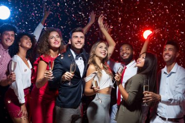 Happy diverse friends celebrating New Year together