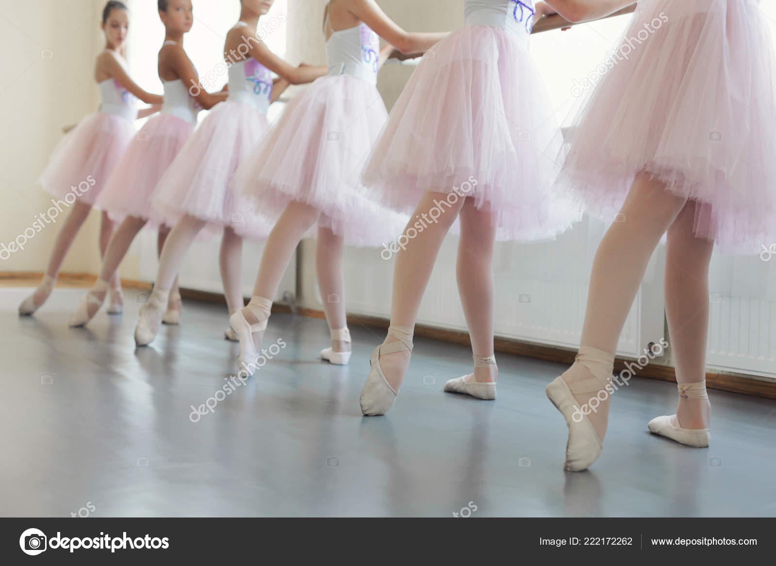 Ballerinas having practice near ballet barre at hall — Stock