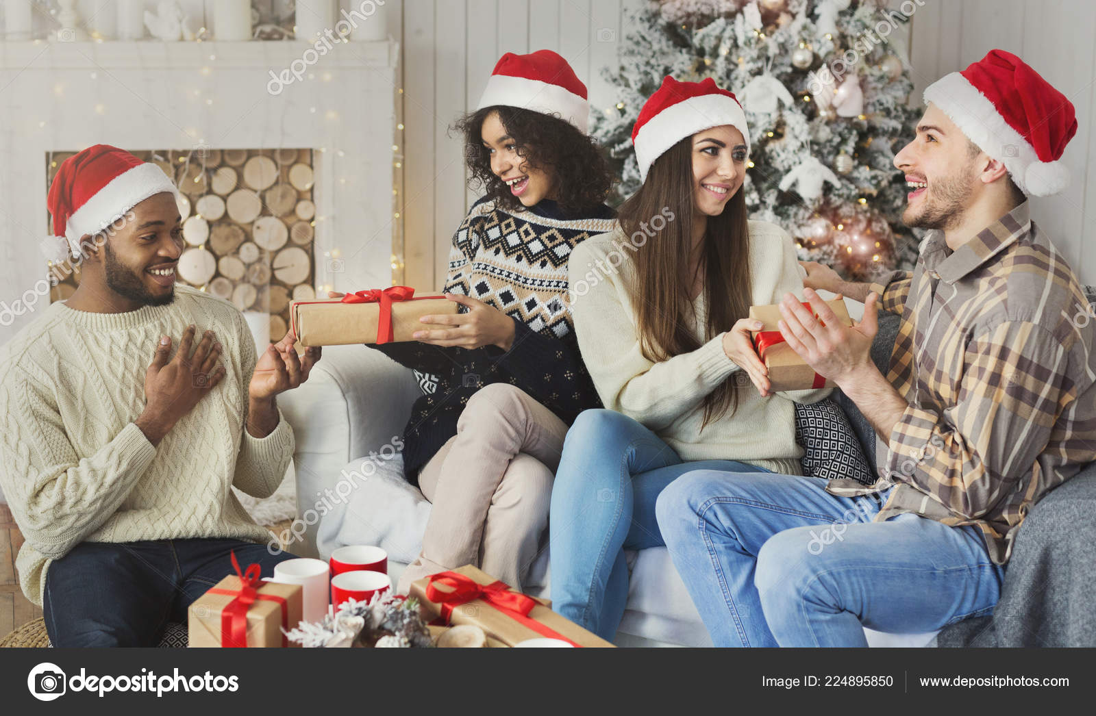 Happy Friends Exchanging Christmas Presents Stock Photo C Milkos