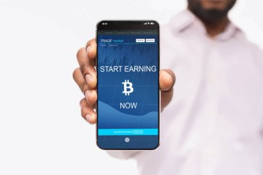 Bitcoin earning application on smartphone screen isolated