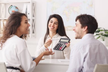 Travel agent showing tour value on calculator