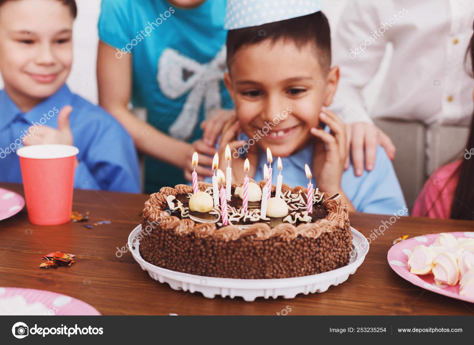 Excellent Birthday Cake Boy Celebrating B Day And Making Wish Stock Photo Personalised Birthday Cards Sponlily Jamesorg