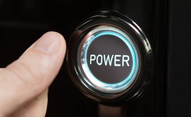 Male finger pushing button with text Power