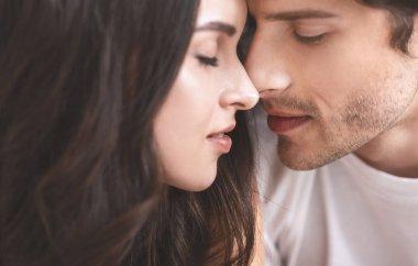 Close up portrait of bonding millennial couple in love