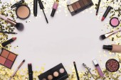 Frame of Makeup accessories, essentials and tools on white