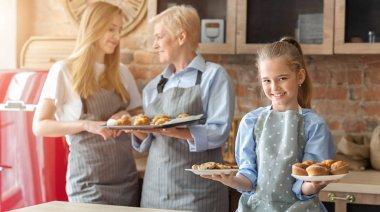 Smiling little girl demonstrating fresh home pastry