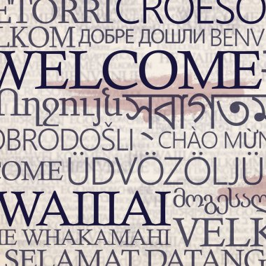 Multinational stand with word welcome in different languages