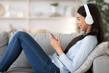 Online Music Service. Happy Asian Girls Listening Her Favorite Songs At Home