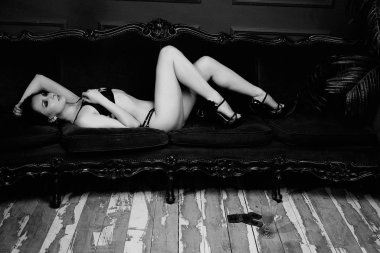 black and white photo of young seductive brunette woman posing