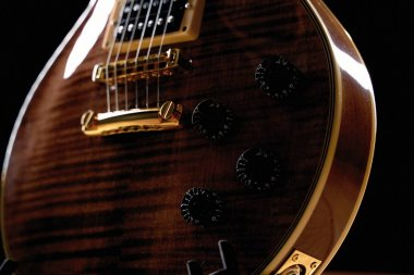 Close-up view of beautiful wooden electric guitar