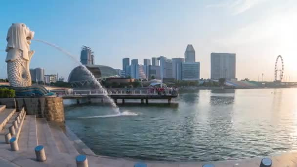 Singapore city, Singapore - April 9, 2018: Time lapse of Merlion with landmark buildings in Singapore city timelapse