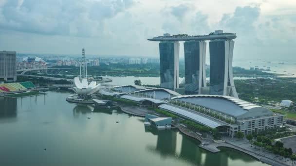 Singapore skyline with landmark buildings day to night time lapse.