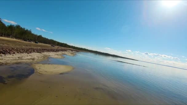 Drone racing view. Low Fly over water coast line. Dynamic shot