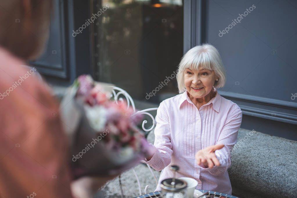 Joyful woman taking present from man on date