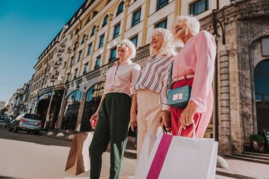Stylish female pensioners are spending time together