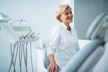 Smiling female doctor is waiting for patient