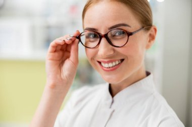 Smiling female doctor is working in clinic