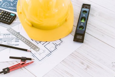 Construction tools with helmet safety on wooden background