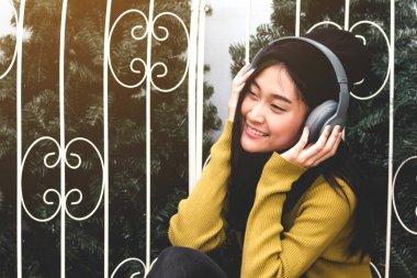 Woman listening music with headphones