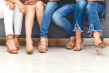 Group of four woman leg sit on sofa