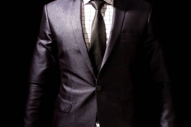 Businessman with black suit on black background