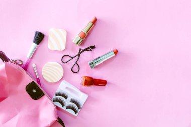 Cosmetics set on pink background