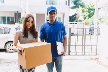 Woman accepting a delivery boxes from delivery man