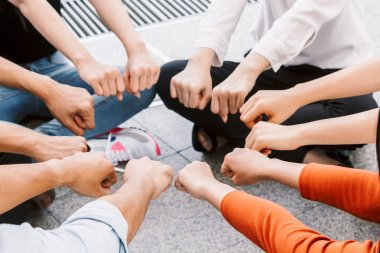 Group of team work people giving fist bump together.friendship concept