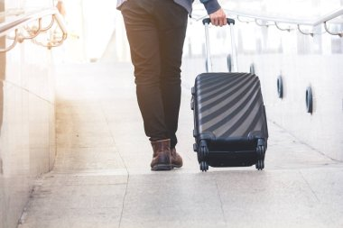 Business people walking with luggage