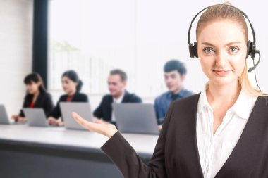 Beautiful businesswoman customer support services working at call center