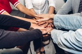 Successful of group business people stack and putting their hands together at office.Friendship teamwork concept