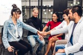 Successful of group business people stack and putting their hand