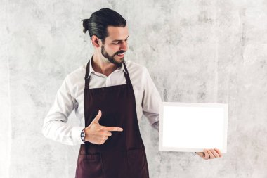 Portrait of handsome bearded barista man small business owner sm