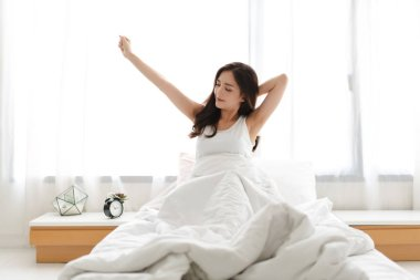 Woman stretching happy and relaxed after wake up in the morning at home stock vector