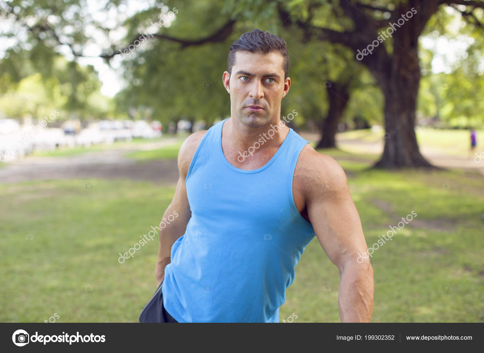 67ddf8c88ec20 Young Athletic Muscular Man Blue Tank Top Outdoors — Stock Photo ...