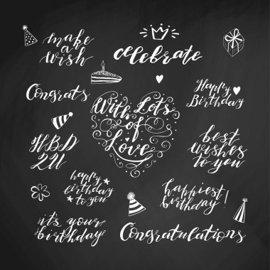 Hand lettering birthday wishes phrases set in white isolated on chalkboard background