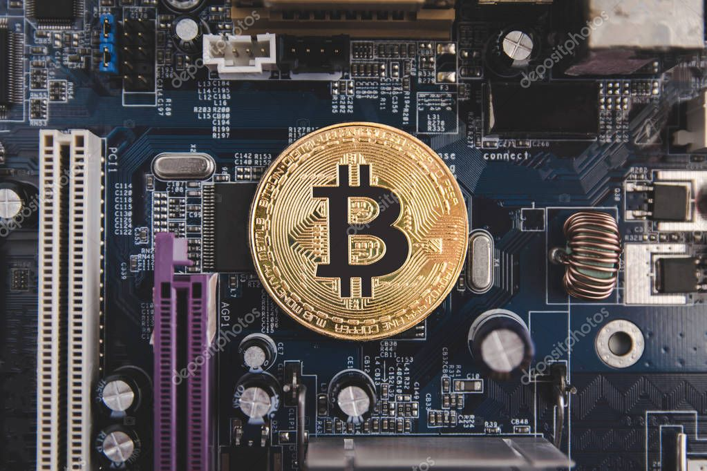 Golden Bitcoin coins on Motherboard, miner with circuit board, pool Cryptocurrency