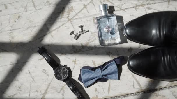 Mans fashion accessories: shoes, spirit, bow tie and wrist watches