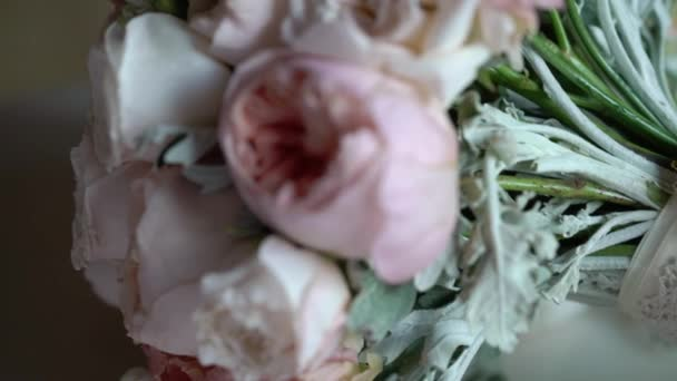 Bridal bouquet on bed