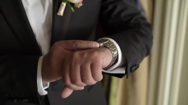 Man looking at wrist watches
